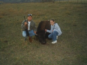 Man With Daughter Next to Buffalo